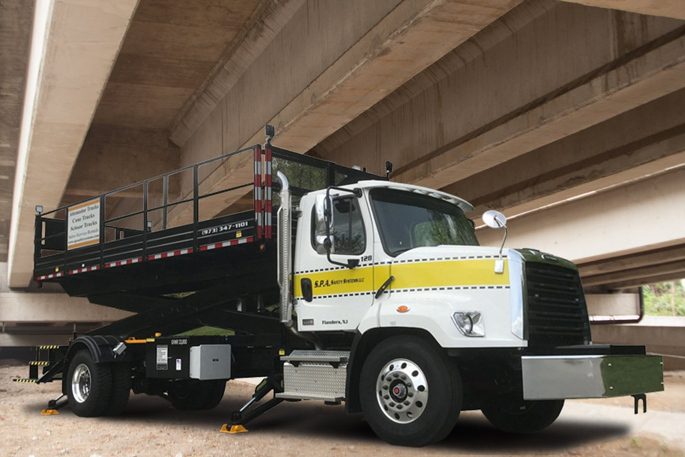 SPA bridge maintenance trucks feature scissor lifts designed for under bridge maintenance and repair work and access for bridge inspections